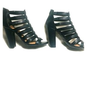 Black leather strappy chunky heels.